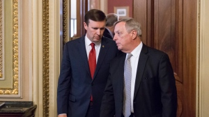 In this photo taken June 14, 2016, Sen. Chris Murphy, D-Conn., left, confers with Senate Minority Whip Richard Durbin, D-Ill., emerge from a closed-door party caucus on Capitol Hill in Washington. Murphy is launching a filibuster and demanding a vote on gun control measures. (AP / J. Scott Applewhite)