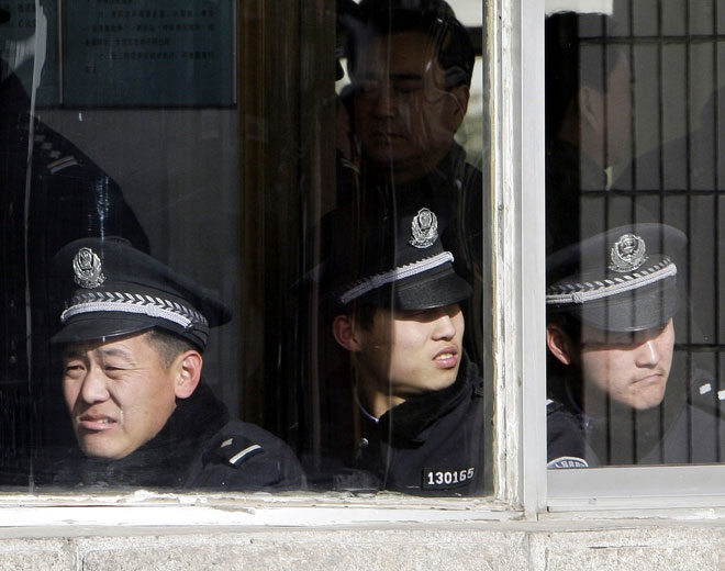 Police officers wait in an office of the Intermediate People's Court in Shijiazhuang, in China's Hebei Thursday Jan. 22, 2009.  (AP / Greg Baker)