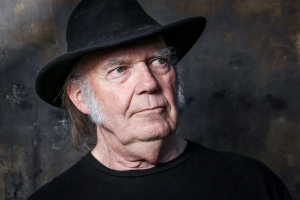 In this May 18, 2016 photo, Neil Young poses for a portrait in Calabasas, Calif., to promote his new album, 'Earth.' (Photo by Rich Fury/Invision/AP)