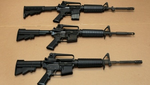Three variations of the AR-15 assault rifle are displayed at the California Department of Justice in Sacramento, Calif., on Aug. 15, 2012. (Rich Pedroncelli / AP)