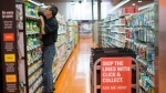 Grant Bone, Department Manager for Loblaw's 'Click and Collect' gathers a customer's order at one of the grocery chain's outlets in Toronto on Thursday, June 16, 2016. (Chris Young / THE CANADIAN PRESS)