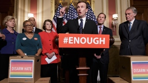 Sen. Chris Murphy, D-Conn., centre, calls for gun control legislation in the wake of the mass shooting in an Orlando LGBT nightclub this week, Thursday, June 16, 2016, on Capitol Hill in Washington. (AP / J. Scott Applewhite)
