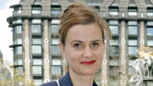 Former Labour Member of Parliament Jo Cox poses for a photograph on May 12, 2015. (Yui Mok/PA via AP, File)