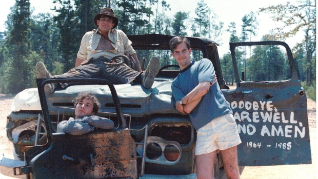 Chris Strompolos, Eric Zala and Jayson Lamb pose with the prop truck used in their remake of Raiders of the Lost Ark. (Drafthouse Films)