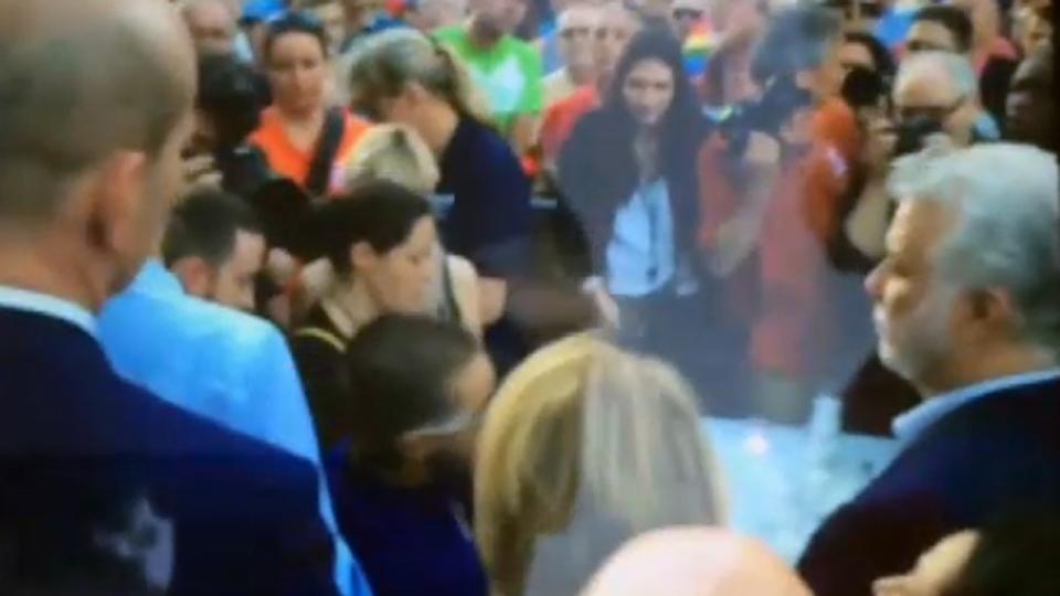 In this screen capture, Esteban Torres, can be seen swinging his arm toward Premier Philippe Couillard