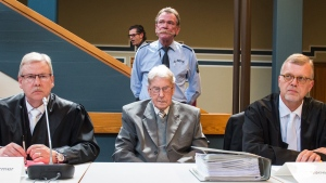 Reinhold Hanning sits between his lawyers Andreas Scharmer, left, and Johannes Salmen, right, in the courtroom in Detmold, Germany on June 17, 2016. (Bernd Thissen / Pool via AP)