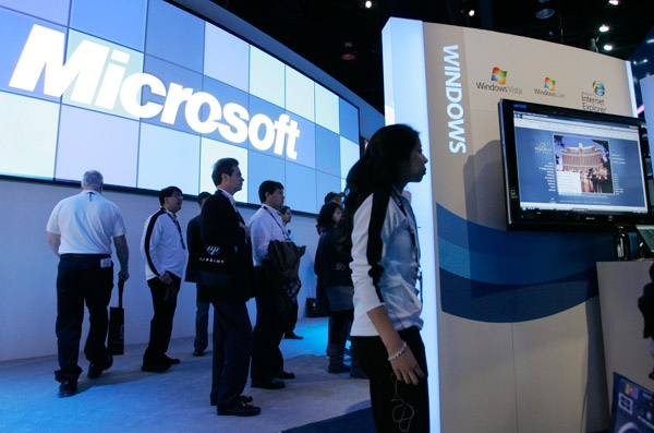 Microsoft's Windows 7 is on display in the Microsoft booth at the International Consumer Electronics Show in Las Vegas on Jan. 8, 2009. (AP / Paul Sakuma)