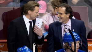 Vancouver Canucks' head coach John Tortorella, right, and Glen Gulutzan in Vancouver, B.C., on April 13, 2014. (Darryl Dyck / THE CANADIAN PRESS)