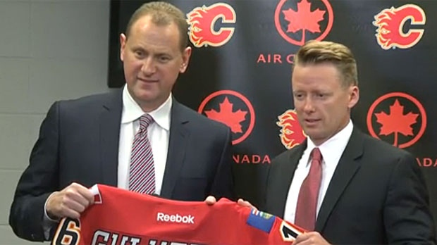 Brad Treliving and Glen Gulutzan appear in a June 2016 image after Gulutzan was named head coach of the Flames.