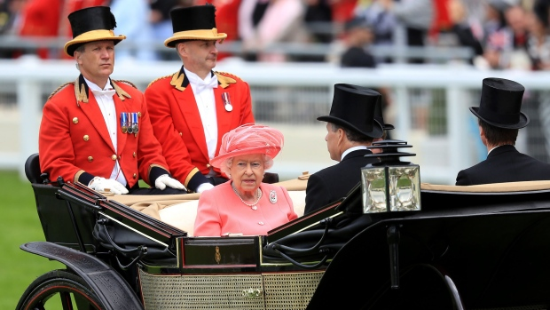 Britain's Queen Elizabeth II arrives with the Prince Philip during day four of the Royal Ascot horse race meeting at Ascot, England, Friday, June, 17, 2016. (David Davies / PA via AP)