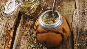 A cup of mate tea, which is drank by sucking on a metal straw called a bombilla, is seen in this undated file photo. (YekoPhotoStudio / Istock.com)