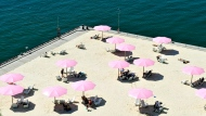 People take in the warm rays of sun on Sugar Beach in Toronto. (THE CANADIAN PRESS/Nathan Denette)