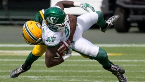 Saskatchewan Roughriders' Ricky Collins (3) is hit by Edmonton Eskimos' C.J. Morgan (2) during second half CFL pre-season action in Edmonton, Alta., on Saturday June 18, 2016. (THE CANADIAN PRESS/Jason Franson.)