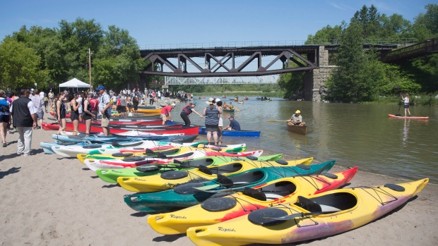"""People enjoy the """"Paddle The Rouge"""" event at Rouge Beach Park in Toronto, Saturday, June 18, 2016. (THE CANADIAN PRESS/Mark Blinch)"""