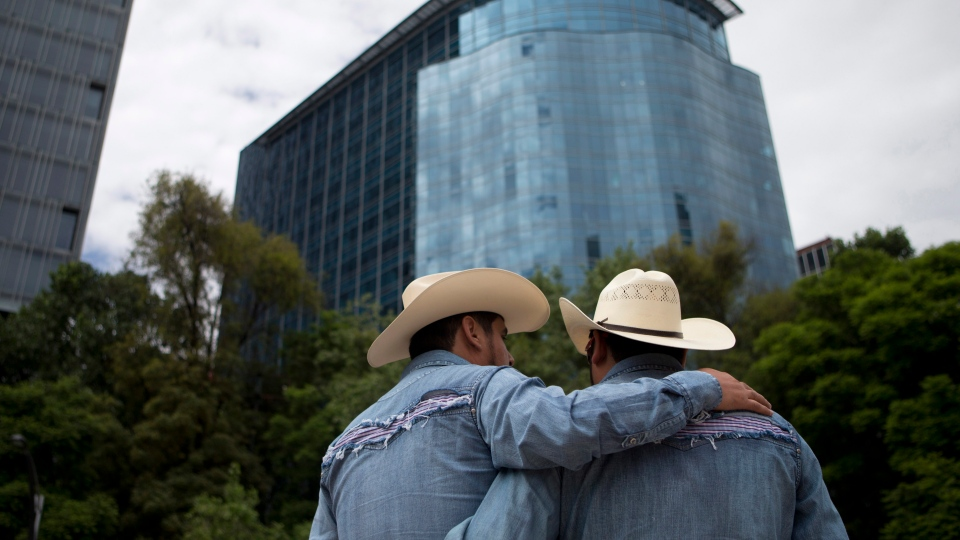 Cowboys stand together at the start of Mexico City's annual gay pride parade, Saturday, June 28, 2014. (AP / Rebecca Blackwell)