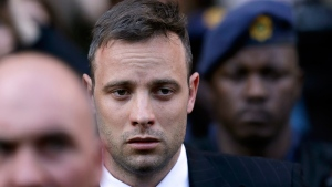 Oscar Pistorius leaves the High Court in Pretoria, South Africa, on June 15, 2016. (Themba Hadebe / AP)
