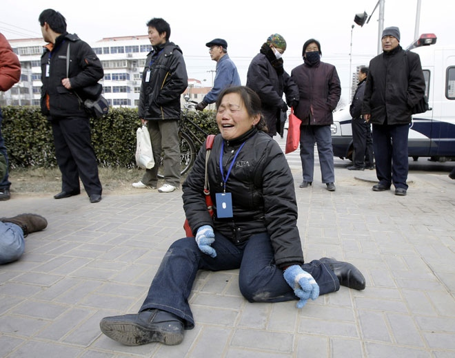 Zheng Shuzhen, center, the grandmother of a baby who died after drinking tainted milk, cries outside the Intermediate People's Court in Shijiazhuang, in China's Hebei province Thursday Jan. 22, 2009.   (AP / Greg Baker)