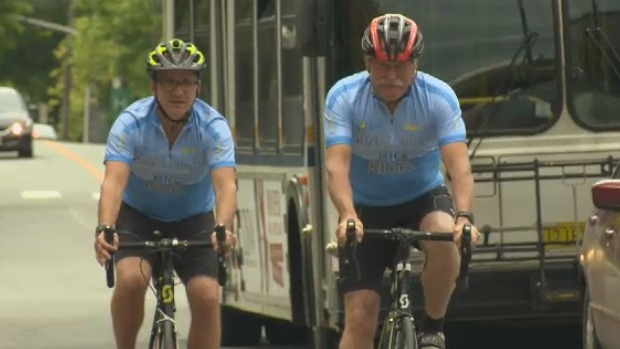 Jeff Langill and Ron Allen ride their bikes in Halifax.