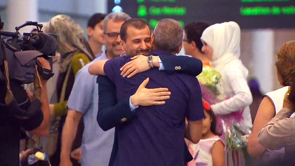 Salim Alaradi is greeted after arriving at Pearson International Airport, in Toronto, Monday, June 20, 2016.