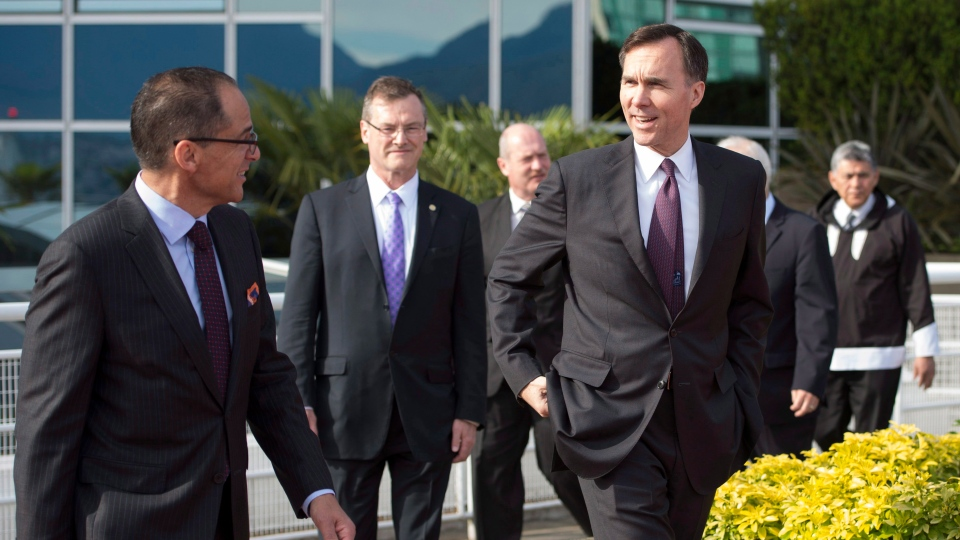 Federal Finance Minister Bill Morneau, right, speaks with Alberta Finance Minister Joe Ceci during a meeting of finance ministers in Vancouver, Monday, June 20, 2016. THE CANADIAN PRESS/Jonathan Hayward