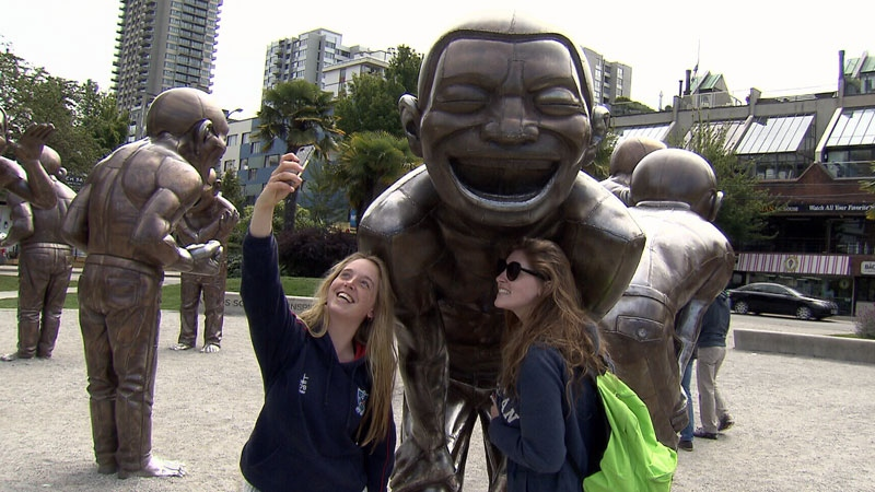 Two sisters snap a selfie in Vancouver on Monday, June 20, 2016.