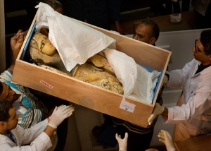 Egyptian antiquities officials carry a lid of a sarcophagus on its arrival to the Egyptian Museum in Cairo, Egypt, Tuesday, June 21, 2016. (AP Photo/Amr Nabil)