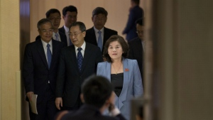 Choe Son Hui, deputy director general of the Department of U.S. Affairs of North Korean Foreign Ministry, walks ahead of Wu Dawei, Chinese special representative for Korean Peninsula Affairs, and other delegates to attend the 26th Northeast Asia Cooperation Dialogue in Beijing Wednesday, June 22, 2016. (AP / Ng Han Guan)