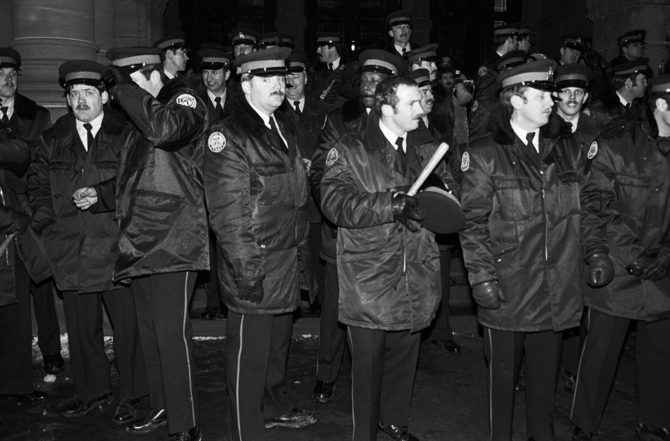 Police officers stand on the steps of the Ontario Legislature in Toronto in the early hours of Feb. 7, 1981 after gay rights demonstrators marched there in protest of the arrests on Feb. 5, 1981 of 253 men in four city steam baths. (THE CANADIAN PRESS/UPC/Gary Hershorn)