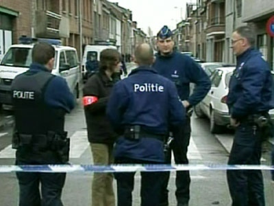 Belgium police officers are seen near a day-care centre after a fatal stabbing by a knife-wielding man on Friday, Jan. 23, 2009.