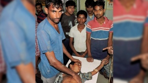 An Indian boy who was injured Tuesday after being struck by lightning receives treatment at the district hospital in Ballia, Uttar Pradesh state, India, Wednesday, June 22, 2016. (Press Trust of India via AP)