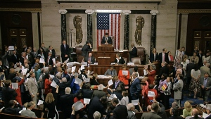 In this image from video provided by House Television, House Speaker Paul Ryan stands at the podium as he brings the House into session in Washington on Wednesday night, June 22, 2016. (House Television)