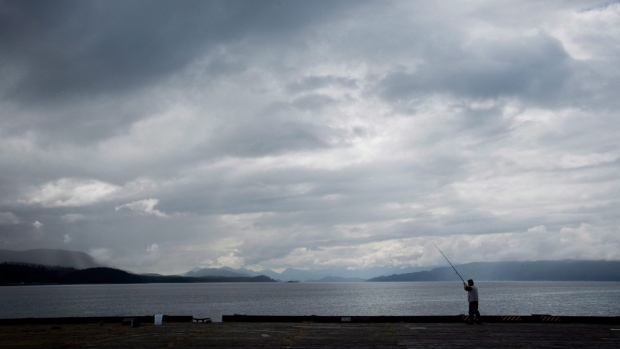 Fishing on the end of a wharf in Sandspit, B.C., on Moresby Island in Haida Gwaii on August 16, 2013. (Darryl Dyck / THE CANADIAN PRESS)