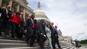 House Minority Leader Rep. Nancy Pelosi of Calif. leads House Democrats down the steps of the Capitol building in Washington, Thursday, June 23, 2016, after ending their sit-in protest. (Evan Vucci / AP)