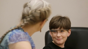 Julian Brown, right, talks with his mother Kristen during a meeting with Jena Daniels, a clinical research coordinator at The Wall Lab in Stanford, Calif., Wednesday, June 22, 2016. Like many autistic children, Brown, 10, has trouble reading emotions in people's faces. (Jeff Chiu/AP Photo)