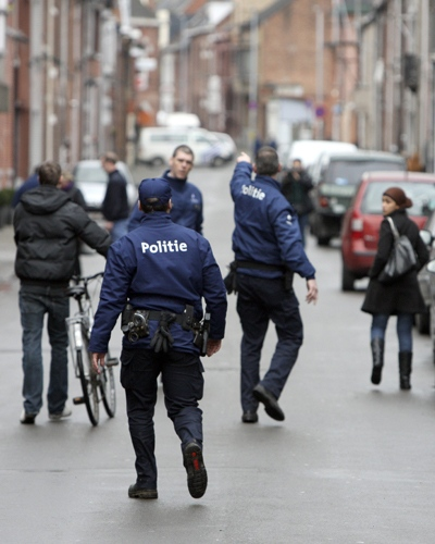 Police officers patrol the scene after a stabbing incident at a daycare center in Dendermonde, Belgium, on Friday Jan. 23, 2009. (AP / Geert Vanden Wijngaert)