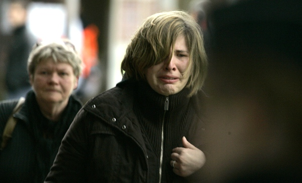 Parents arrive at a crisis center after a stabbing incident at a daycare centre in Dendermonde, Belgium, Friday Jan. 23, 2009. (AP / Virginia Mayo)