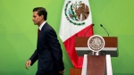 Mexican President Enrique Pena Nieto leaves the podium at the National Palace in Mexico City, on Tuesday, June 21, 2016. (AP Photo/Rebecca Blackwell)