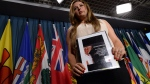 Mexican human rights defender Brenda Rangel Ortiz holds a picture of her missing brother as she takes part in a press conference on Parliament Hill in Ottawa on Thursday, June 23, 2016. (Sean Kilpatrick / THE CANADIAN PRESS)