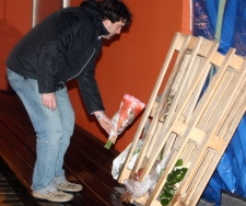 A man lays flowers at a daycare center after a stabbing incident in Dendermonde, Belgium, on Friday Jan. 23, 2009. (AP / Geert Vanden Wijngaert)