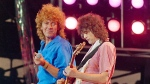 Led Zeppelin bandmates, singer Robert Plant, left, and guitarist Jimmy Page, reunite to perform for the Live Aid famine relief concert at JFK Stadium in Philadelphia on July 13, 1985. (AP / Amy Sancetta)