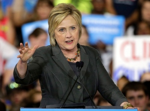 In this June 22, 2016, photo, Democratic presidential candidate Hillary Clinton gestures as she speaks during a rally in Raleigh, N.C. (AP Photo/Chuck Burton)