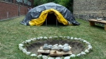 A sweat lodge and a sacred fire are pictured on the grounds of the Centre for Addiction and Mental Health in Toronto on Thursday, June 23, 2016.  (THE CANADIAN PRESS/Chris Young)