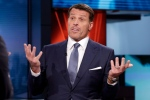 Tony Robbins, motivational speaker, personal finance instructor, and self-help author, is interviewed by host Anthony Scaramucci and Maria Bartiromo during the taping of 'Wall Street Week,' on the Fox Business Network, in New York, Thursday, March 17, 2016. (AP Photo/Richard Drew)