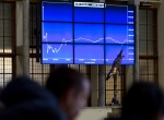 Visitors look at a graph showing the sharp fall of the AEX index following the British Brexit vote at the Euronext Amsterdam Stock Exchange, Netherlands, Friday, June 24, 2016. (AP Photo/Peter Dejong)