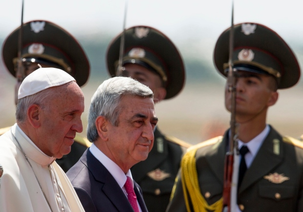 Pope Francis, left, and Armenian President Serzh Sargsyan, review honour guards shortly upon arrival to Zvaretnots airport in Yerevan, Armenia, Friday, June 24, 2016. Pope Francis is in Armenia for a three-day visit. (AP Photo/Alexander Zemlianichenko)
