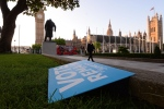 Vote Remain poster lies discarded on the ground in London's Parliament Square. (Stefan Rousseau/PA via AP, File)