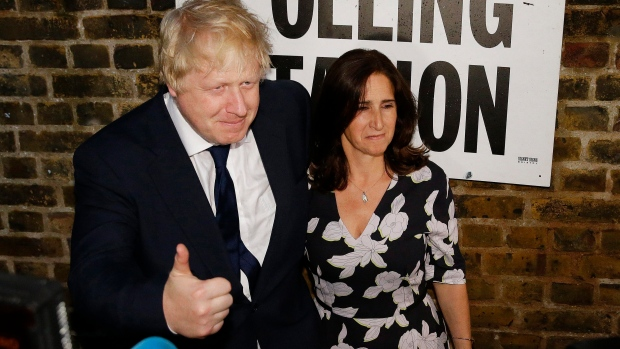 British MP Boris Johnson and his wife Marina are photographed as they leave after voting in the EU referendum in London, on Thursday, June 23, 2016. (AP Photo/Matt Dunham)
