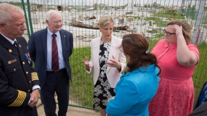 Fire Chief Darby Allen, left to right, Gov. Gen. David Johnston, Sophie, Countess of Wessex, Regional Municipality of Wood Buffalo Mayor, Melissa Blake and Deputy Premier of Alberta Sarah Hoffman look over the devastation during a visit to Fort McMurray Alta, on Friday June 24, 2016. (THE CANADIAN PRESS/Jason Franson)