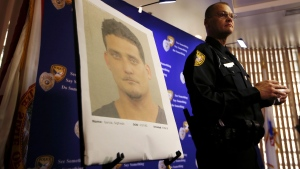 Tallahassee Police Department Public information officer David Northway reveals an image of Sigfredo Garcia, 34, during a press conference in Tallahassee, Fla., Thursday, May 26, 2016. (Joe Rondone/Tallahassee Democrat via AP)