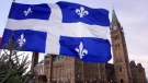The flag of Quebec flies in this undated file photo. (Tom Hanson/The Canadian Press)